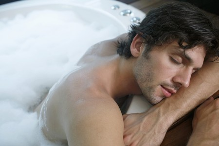 Man taking a nap while in bubble bath