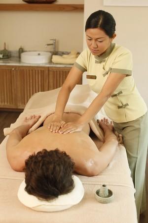 Massage therapist massaging man's back Stock Photo - 6974268