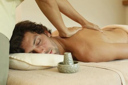 Massage therapist massaging man's back Stock Photo - 6974271