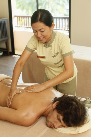 Massage therapist massaging man's back Stock Photo - 6974273