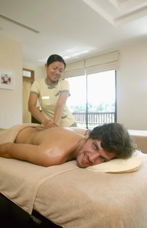 Massage therapist massaging man's lower back Stock Photo - 6974274