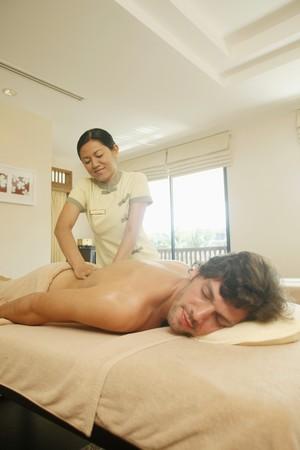 Massage therapist massaging man's lower back Stock Photo - 6974275