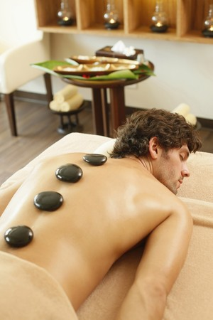 Hot stones on man's back Stock Photo - 6974277