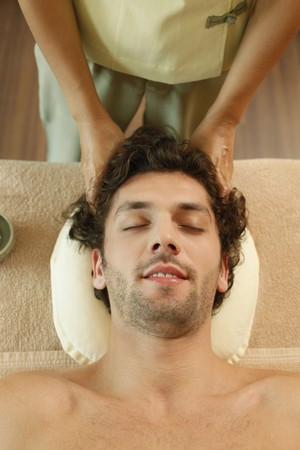 Massage therapist massaging man's head Stock Photo - 6974280