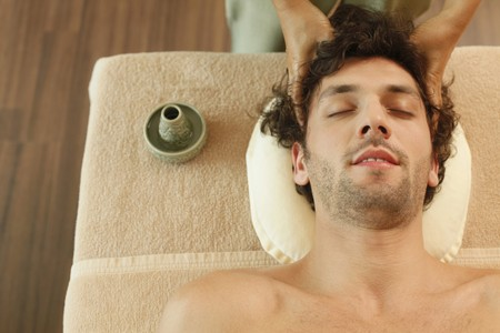 turkish ethnicity: Massage therapist massaging mans head Stock Photo