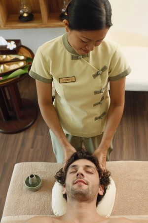 Massage therapist massaging man's head Stock Photo - 6974282