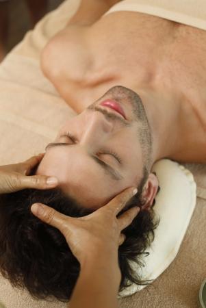 Massage therapist massaging man's head Stock Photo - 6974284