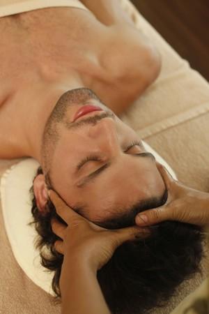 Massage therapist massaging man's head Stock Photo - 6974285