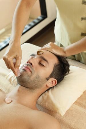 Man receiving crystal healing treatment Stock Photo - 6974289
