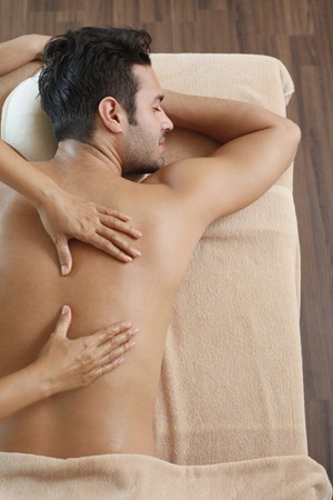 Man receiving massage from a massage therapist Stock Photo - 6974301