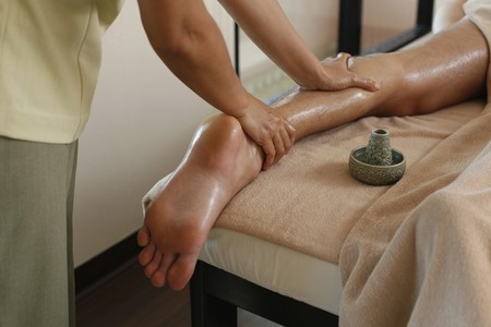 Man receiving leg massage from a massage therapist Stock Photo - 6974302