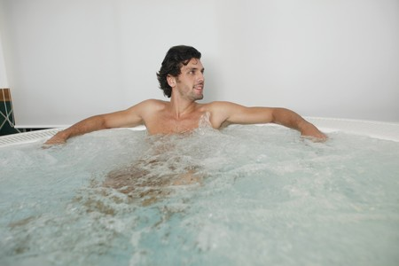 turkish ethnicity: Man relaxing in hot tub Stock Photo