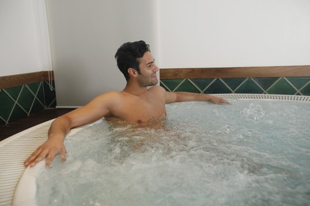 southeastern european descent: Man relaxing in hot tub Stock Photo