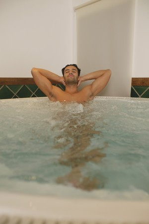 Man relaxing in hot tub with eyes closed Stock Photo - 6974307