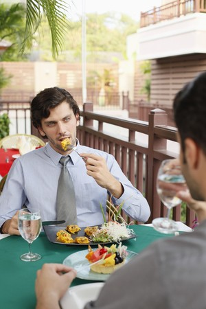 Businessmen having lunch together at a restaurant Stock Photo - 6974314
