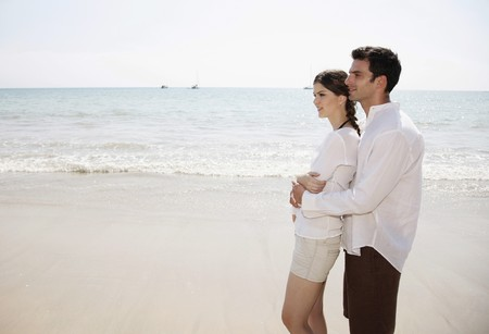 Man and woman embracing on beach Stock Photo - 7086534
