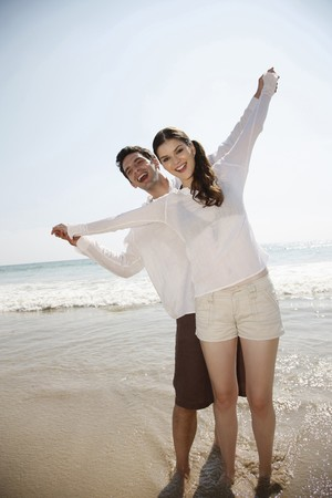 Man and woman with arms stretched out photo