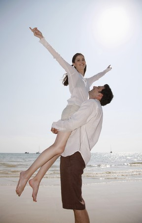 Man lifting up woman Stock Photo - 7086541