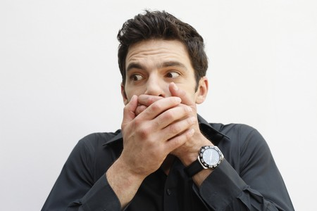 Man covering mouth with hands Stock Photo - 7076999
