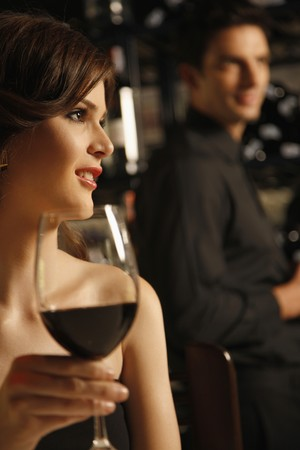 glass of red wine: Woman with a glass of red wine