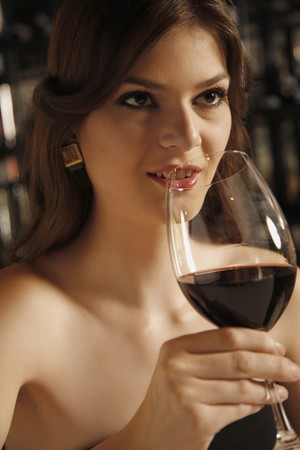 southeastern european descent: Woman with a glass of red wine