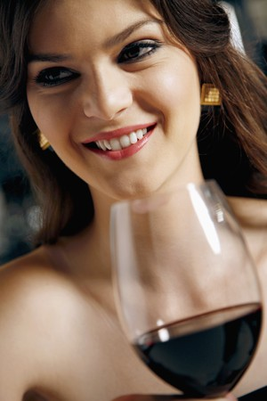 Woman with a glass of red wine photo