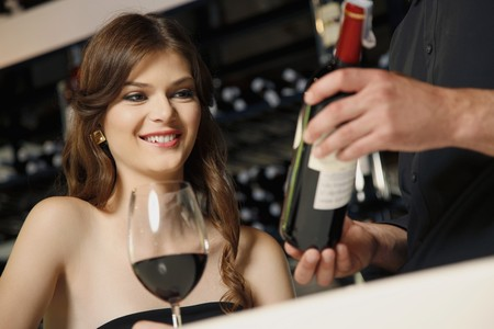 Man recommending good wine to woman Stock Photo - 7077032