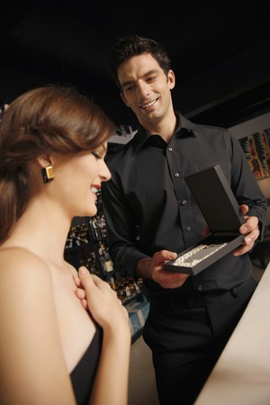Man giving woman a surprise gift Stock Photo - 7077033