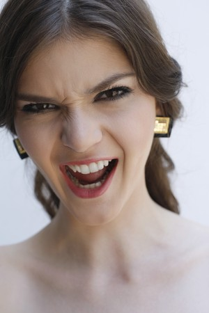 Woman frowning and scolding photo