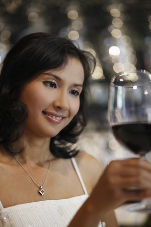 Woman looking at glass of red wine Stock Photo - 7077031