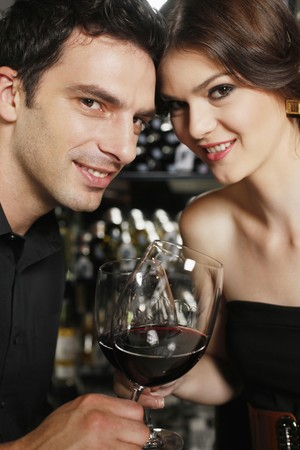 Man and woman toasting Stock Photo - 7077041