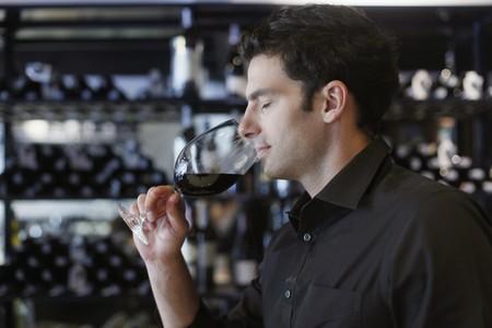 Man enjoying a glass of wine photo