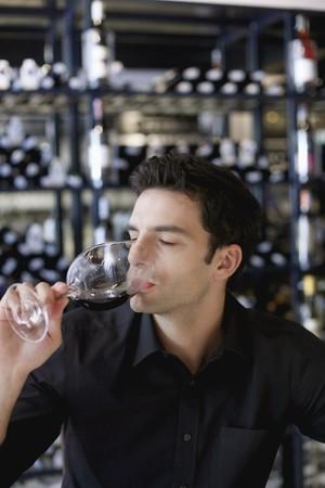 Man drinking red wine photo