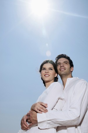 Man and woman embracing on the beach Stock Photo - 7076992