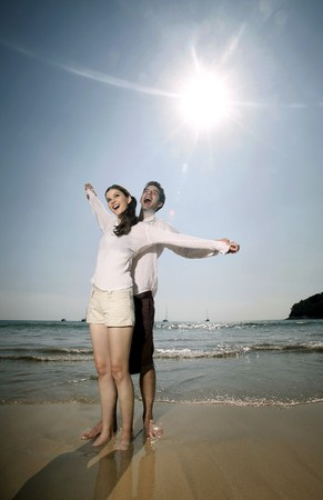 Man and woman with arms stretched out Stock Photo - 7077051