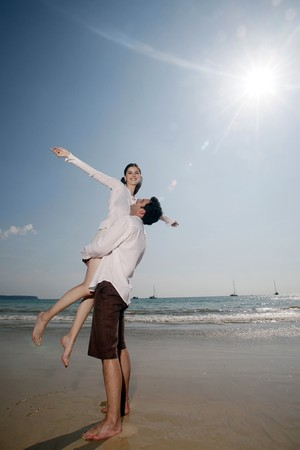 Man lifting up woman Stock Photo - 7076995