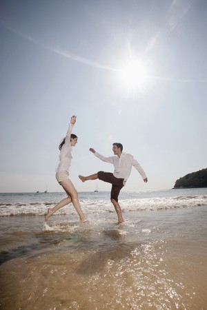 Man and woman playing on beach Stock Photo - 7077045