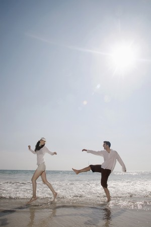 Man and woman playing on beach Stock Photo - 7077007