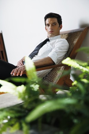 Businessman resting on lounge chair photo