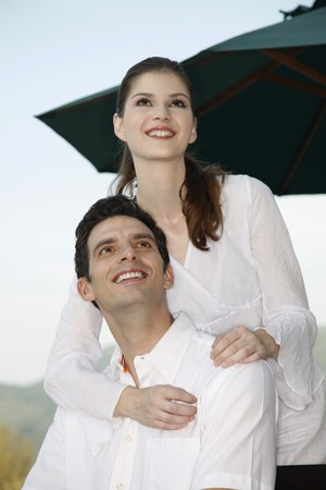 Man and woman smiling and looking up photo