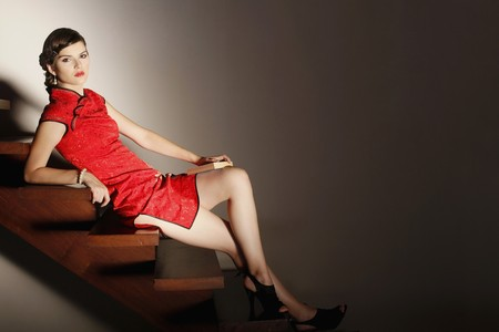 Woman in cheongsam posing on the stairs Stock Photo - 7131623