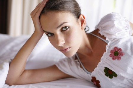 Woman lying on bed Stock Photo - 7172779