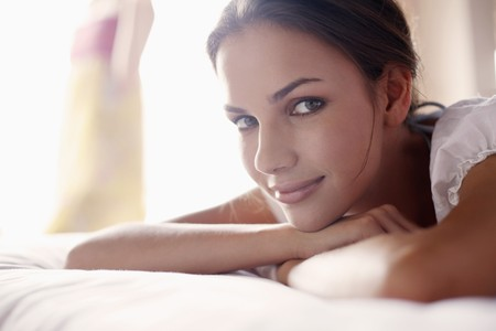 Woman lying on the bed photo