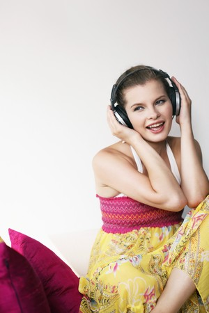Woman listening to music on headphones Stock Photo - 7131603