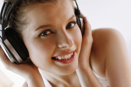 Woman listening to music on headphones Stock Photo - 7131647
