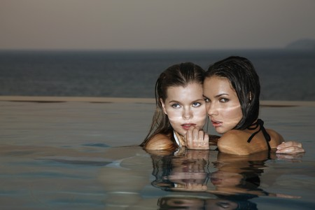 Women together in pool photo