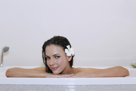 Woman resting at the edge of bathtub Stock Photo - 7172750