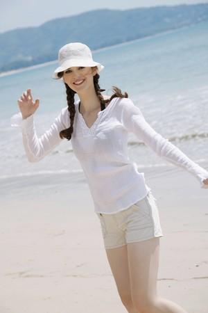 southeastern european descent: Woman having fun on the beach