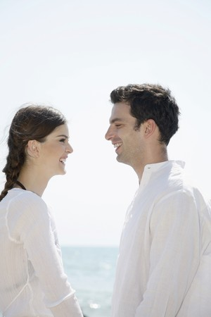 Man and woman smiling while looking at each other Stock Photo - 7355991