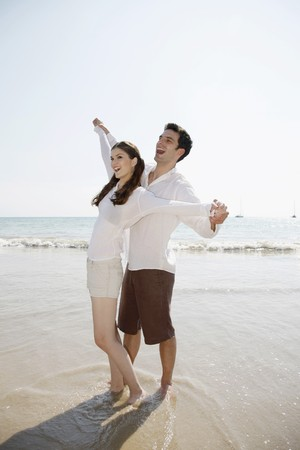 Man and woman with arms stretched out Stock Photo - 7355979